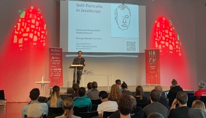 George Mandis presenting 'Self-Portraits in JavaScript' at Halfstack Vienna